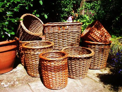 Variety of willow baskets for logs and waste paper