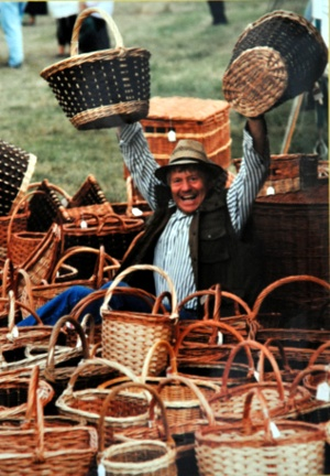 man surrounded by baskets